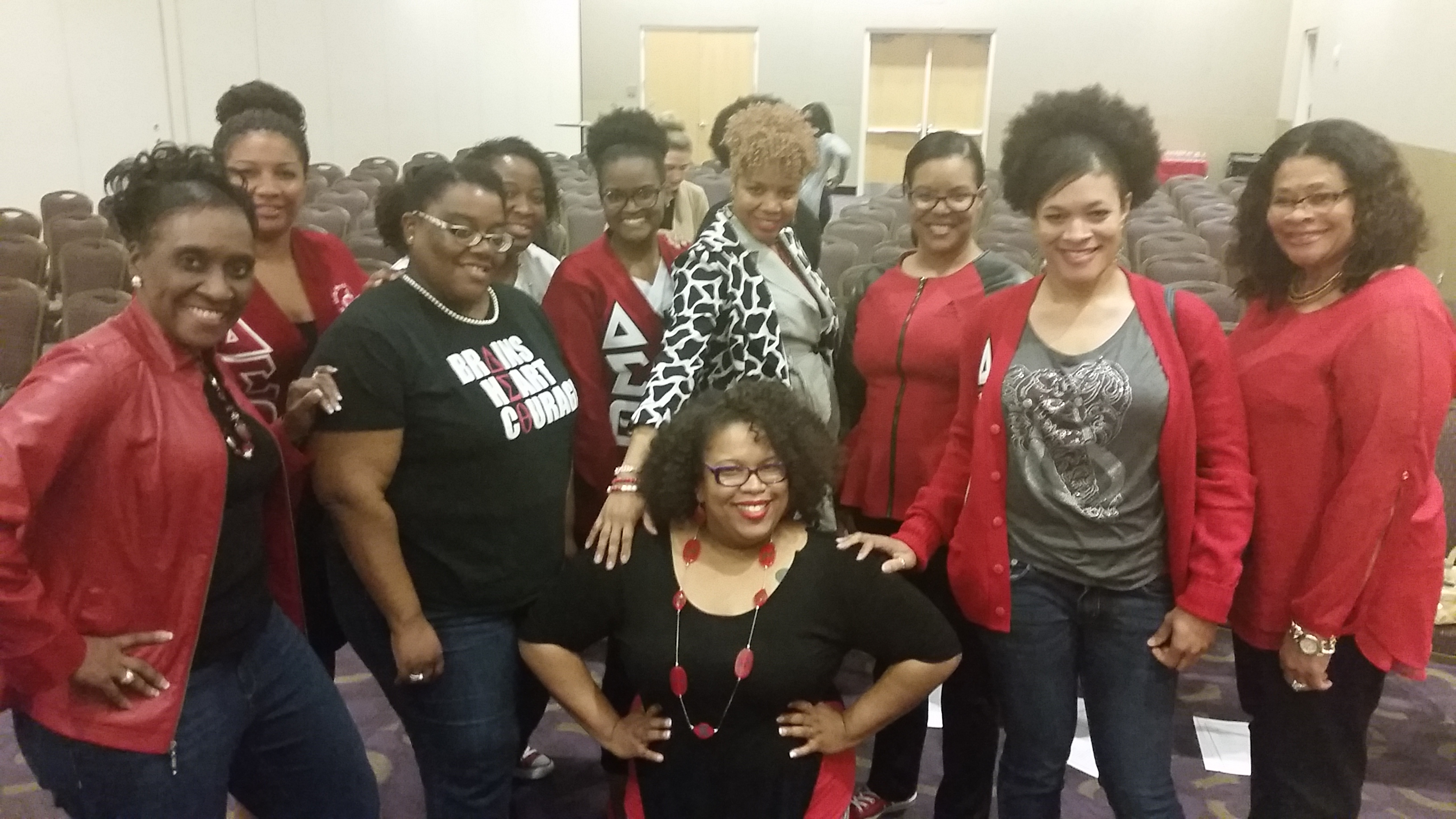 Goody Howard smiling with members of Delta Sigma Theta Sorority, Inc