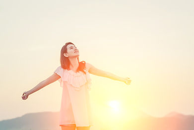 girl-with-arms-stretched-sun.jpg