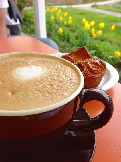Brown Bear Baking Victrola coffee latte in the garden