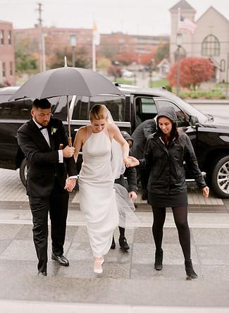 bride-arrives-at-church-in-rain.jpg