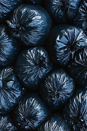 pile-of-black-plastic-garbage-bags-Veerp