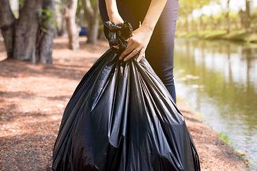 woman-volunteer-holding-black-color-garb