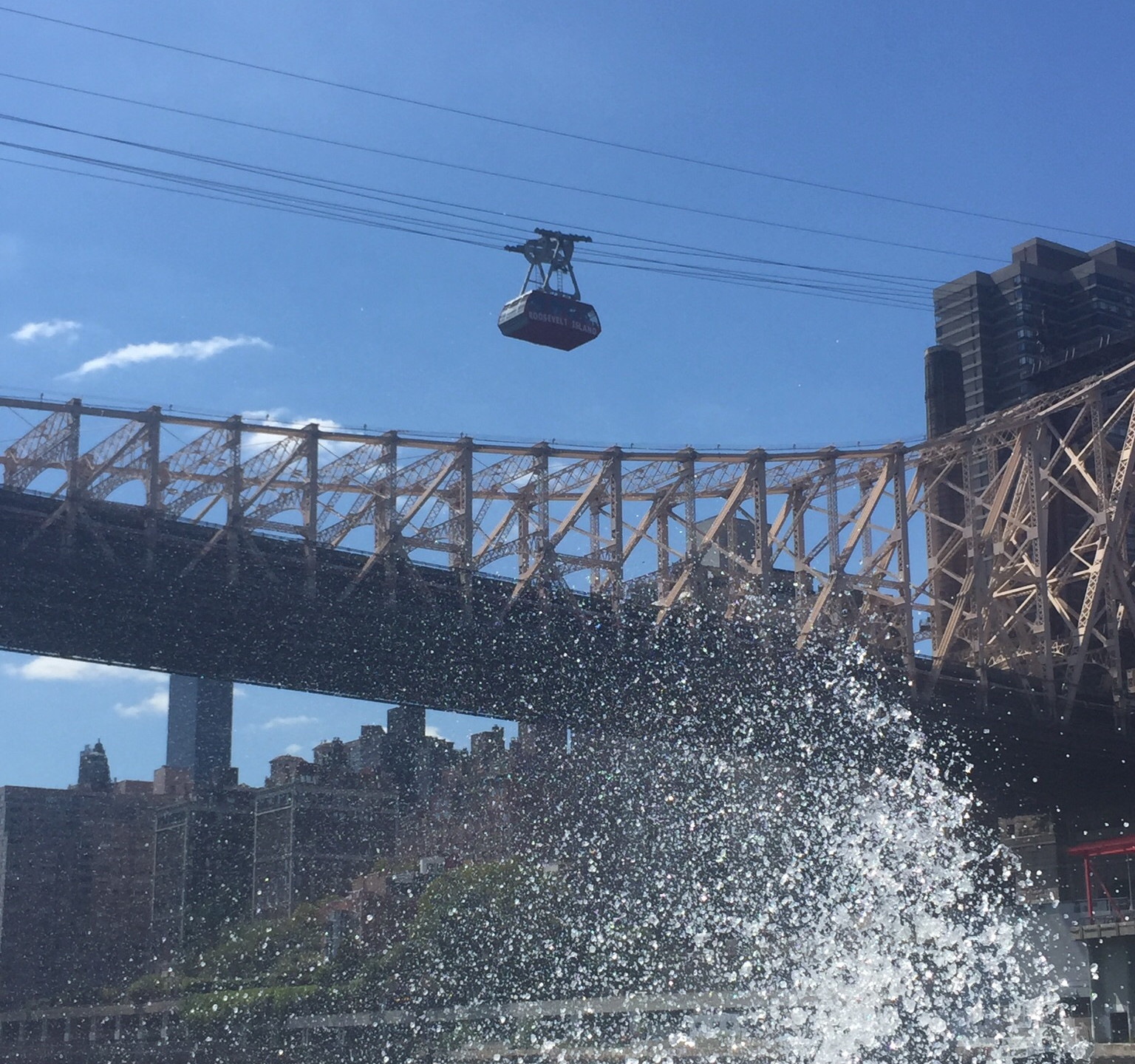 Going under the 59th Street Bridge there's a tram that takes passengers to Roosevelt Island.