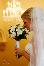 Bride holding her white and green bridal bouquet
