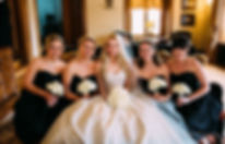 Bridal Party holding rose bouquets