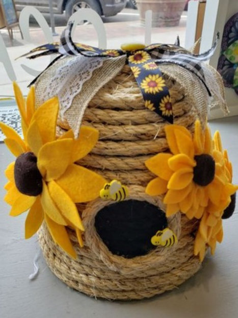 Rope beehive with felt sunflowers