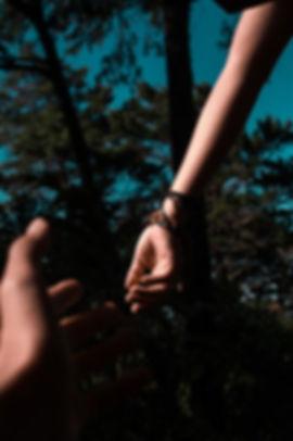 hands reaching toward each other.jpg