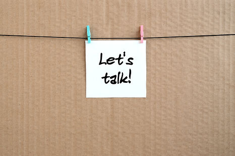 Let's talk! Note is written on a white s