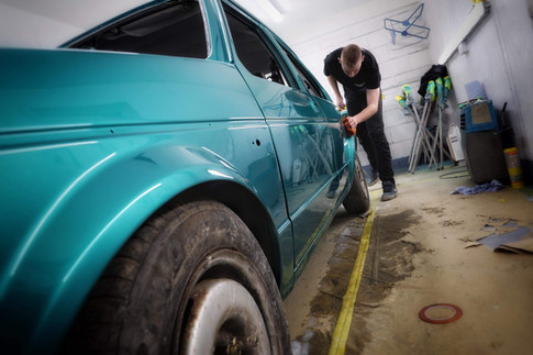 Steve Swann carrying out final polishing on MK1 Golf after respray