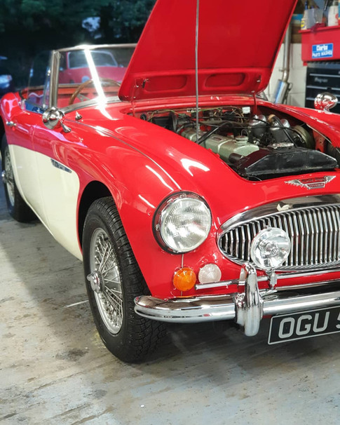 Austin Healey in for panel work and semi-restoration including respray.