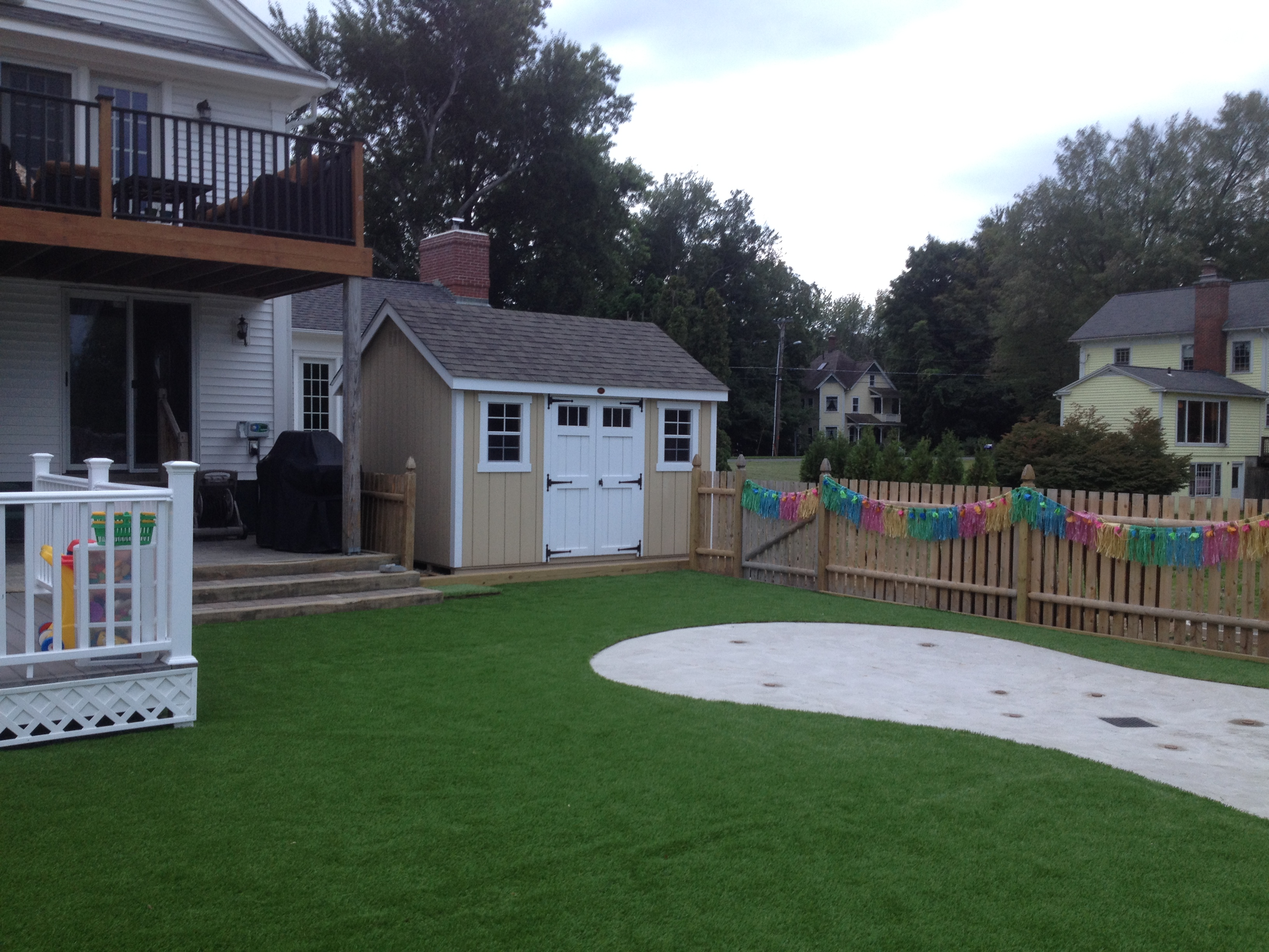 Shed and artificial turf play area