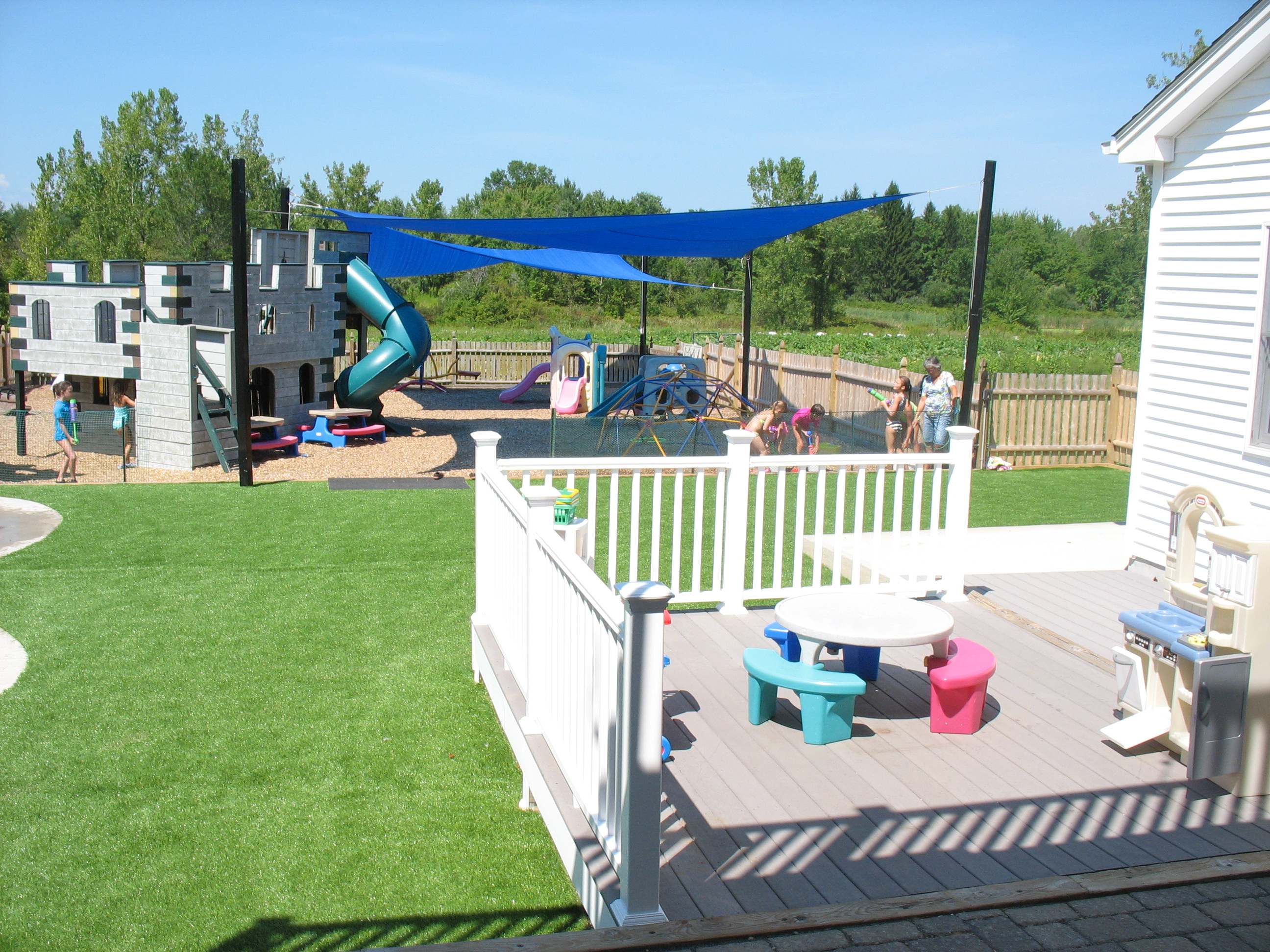 deck with playground in back