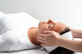 Close up of practitioner doing reiki wit