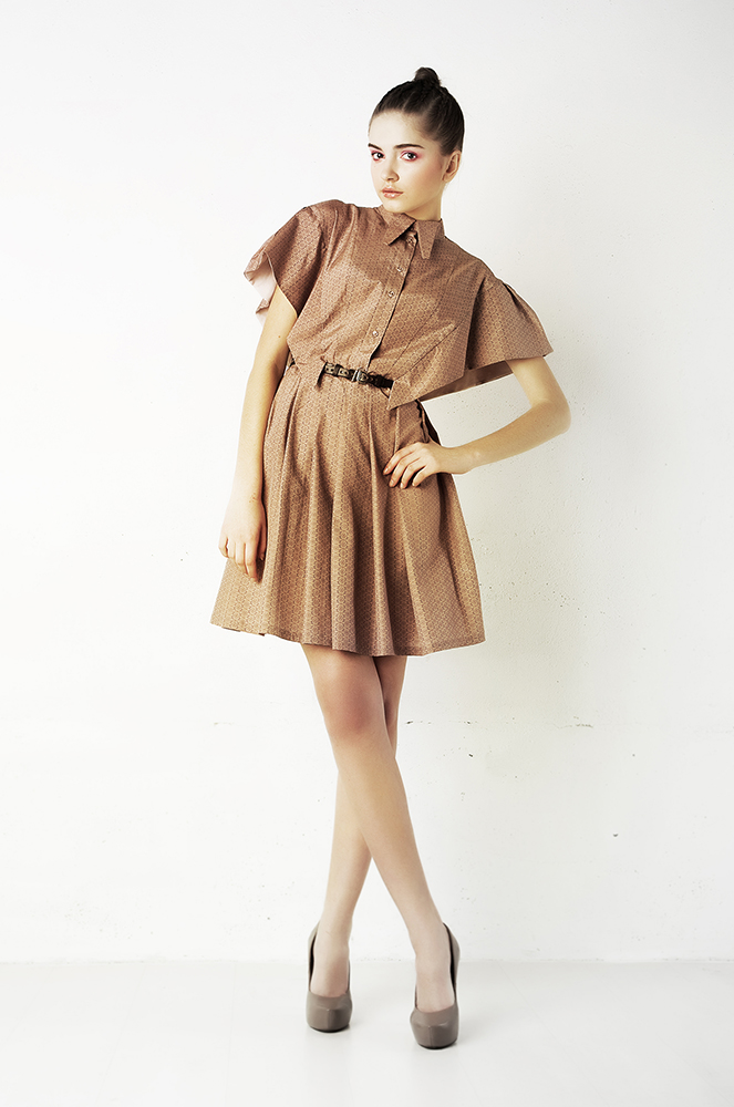 Model in brown silk dress