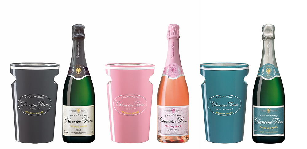Bottles of Chanoine Frères Réserve Privée champagnes, Brut, Rosé and Vintage 2013 cuvées and assorted ice buckets for the holidays