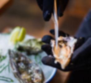 person chucking oyster_edited.jpg