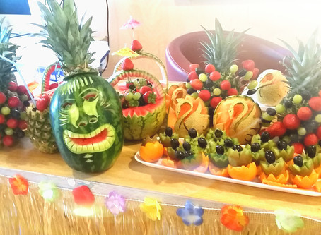 Fruitima does Hawaiian Themed Fruit Carving Workhops with Roots & Shoots & Brandfuel - Lond