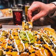 nachos beer hand.jpg