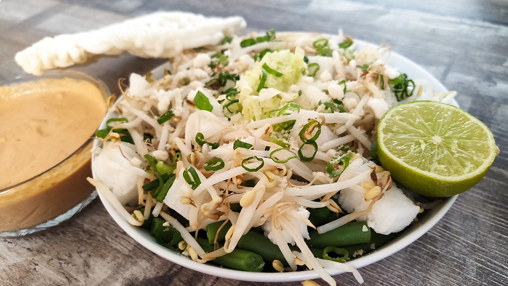 Lotek, Indonesian vegetable salad with a spiced fresh peanut dressing, crushed prawn crackers, fried shallots and lime