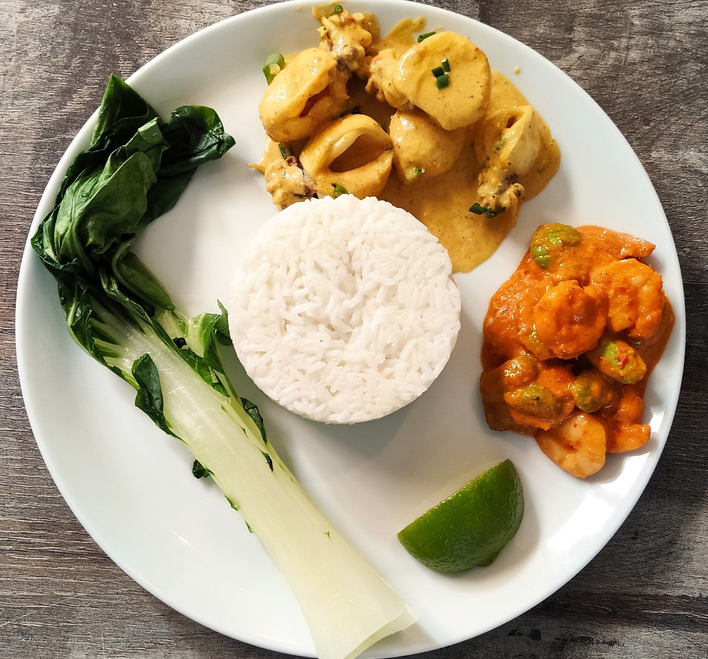 Plate with Kare Cumi (squid curry) Sambal Goreng Udang Peteh (fried chili shrimp with peteh beans), Nasi Putih (white rice) and steamed bok choy