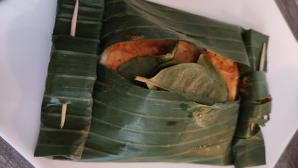 Ikan Pepesan Indonesian cod steamed in banana leaf with herbs and spices