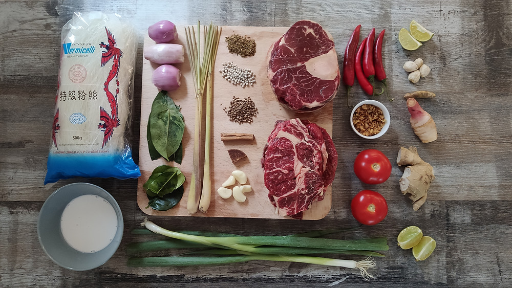 Ingredients for Soto Betawi, Indonesian beef soup from Jakarta on a table