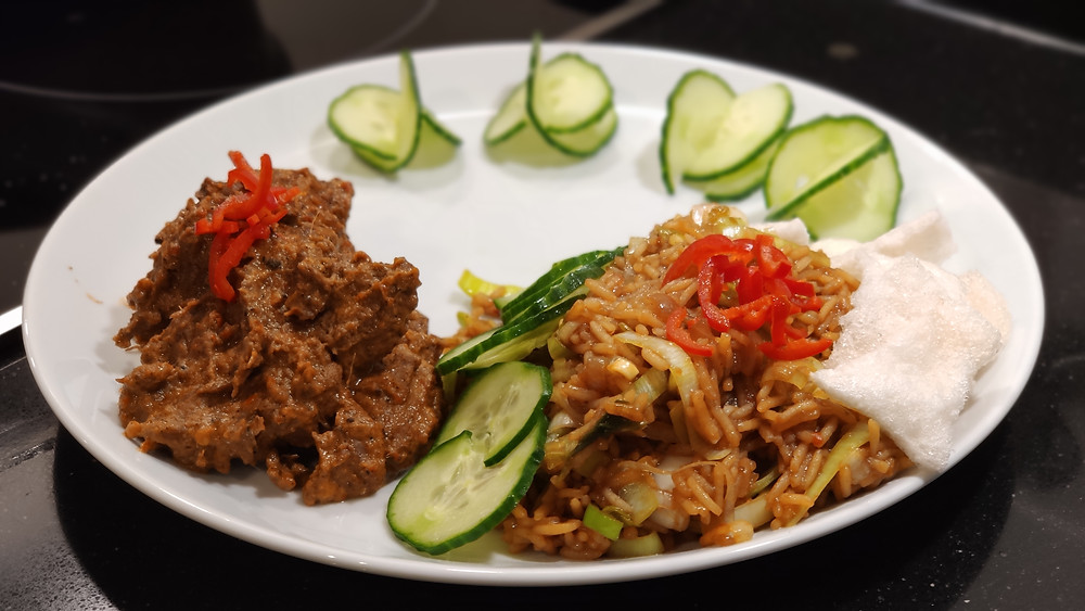 Rendang Daging, Indonesian beef coconut stew (left side) with Nasi Goreng (fried rice), cucumber and kerupuk (prawn crackers)