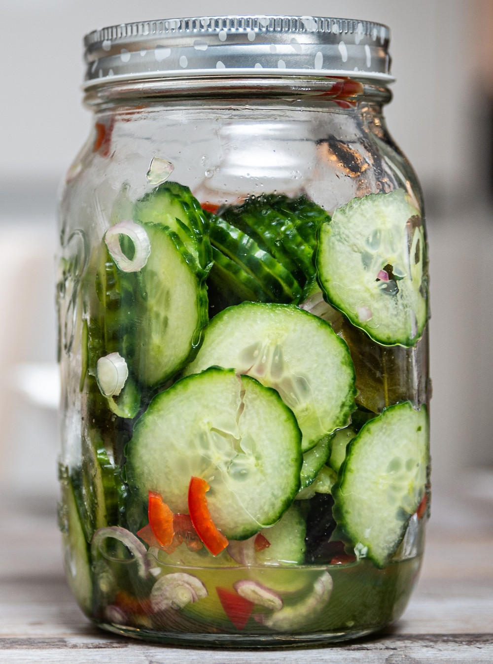 Acar Ketimun, Indonesian pickled cucumber with shallots and chilies in a mason jar