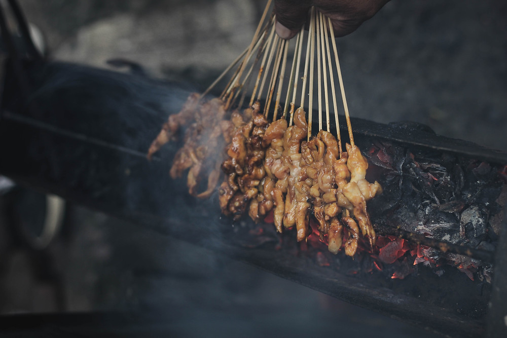Saté Ayam: Indonesian chicken satay skewers grilled on charcoal