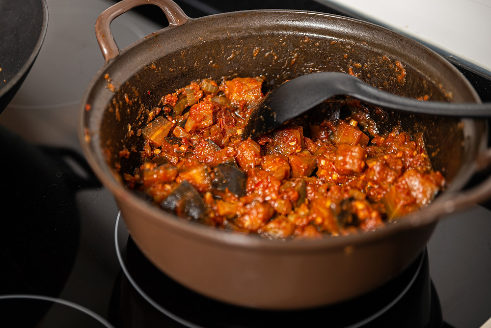 Terong Balado, Indonesian sweet and spicy eggplant in tomato sauce in a Dutch oven.