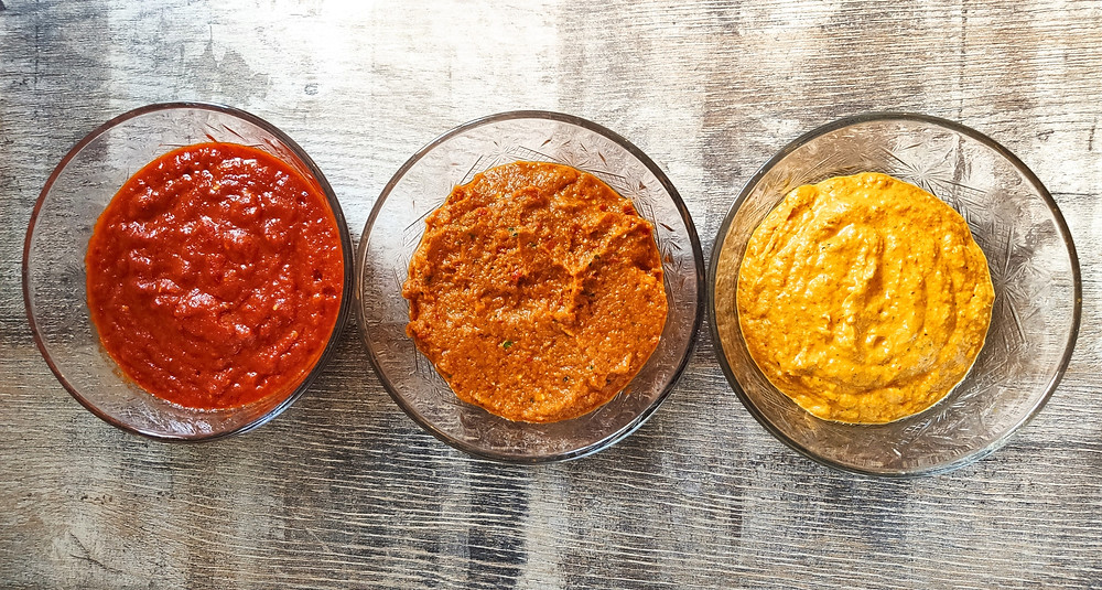 Different colored Indonesian spice pastes (bumbu)