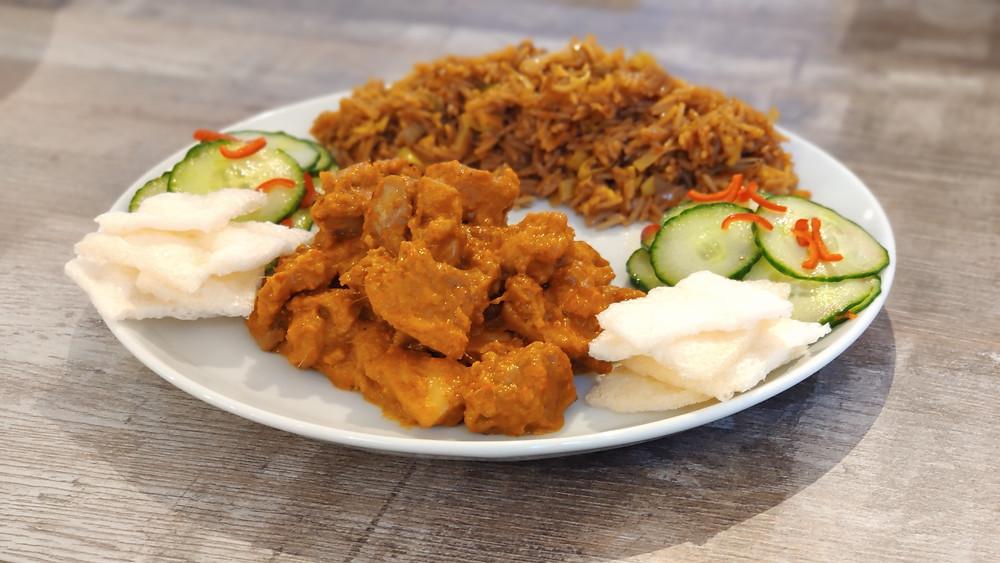 Home-made Ayam Rica Rica with Nasi Goreng (fried rice), Acar Ketimun (pickled cucumber) and Kerupuk (prawn crackers)