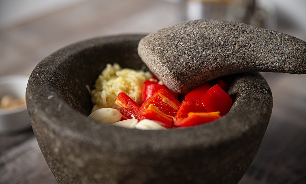 Indonesian pestle and mortar with chillies, garlic and ginger
