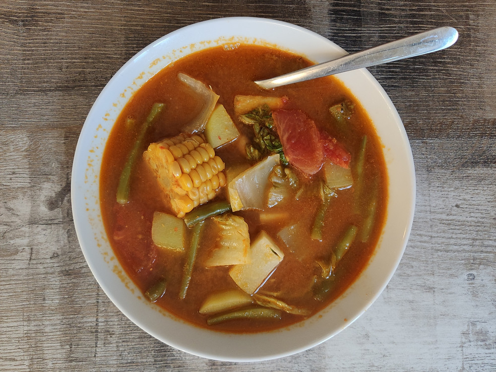 Sayur Asem, Indonesian tamarind vegetable soup, with vegetables such as chayote, Chinese cabbage, green beans, sweet corn and tomatoes, served in a soup bowl