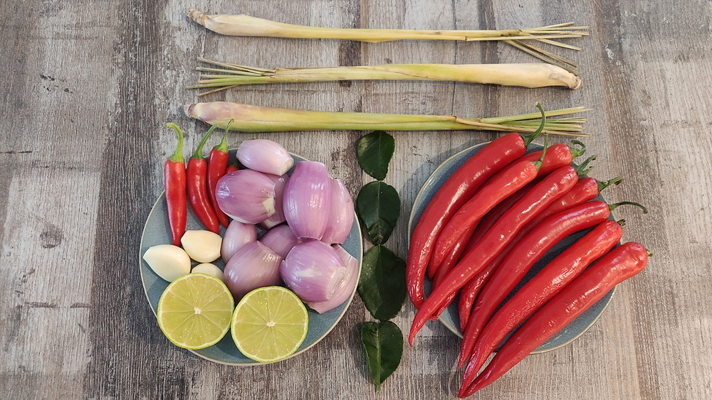 Sambal ingredients such as Spanish and rawit chillies, garlic, shallots, lemongrass, kaffir lime leaves and lime