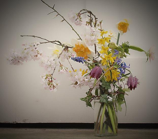 eco glass jar of seasonal blooms