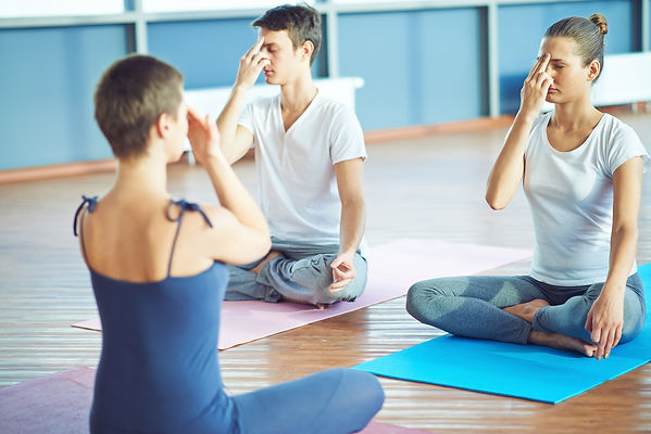 Girl and guy repeating yoga exercise aft