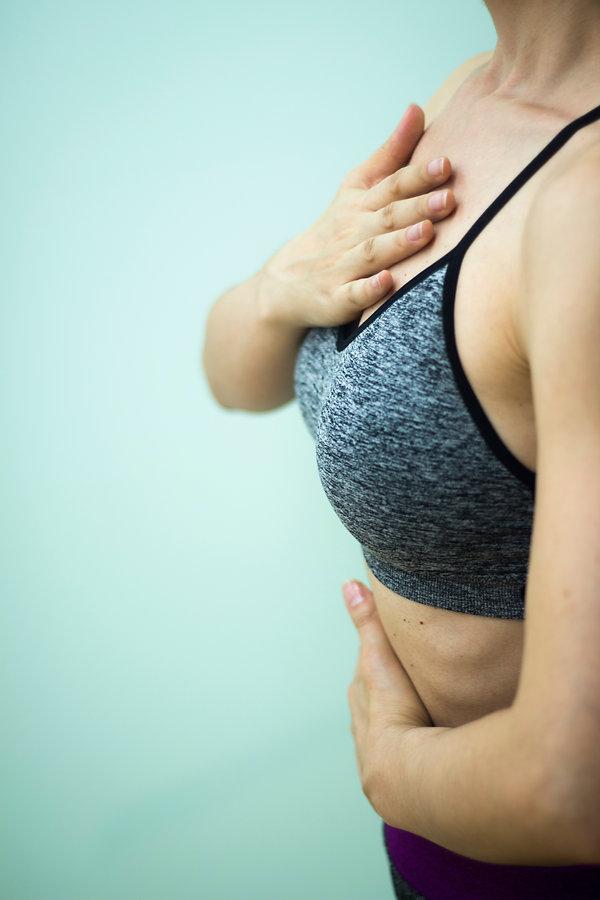 Female instructor yoga teacher teaching