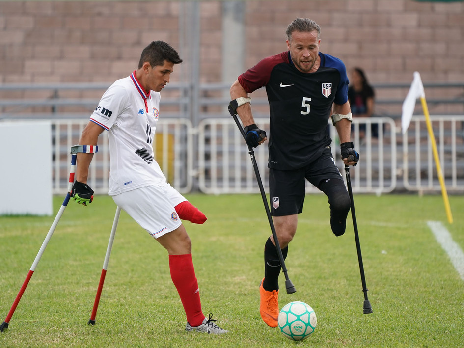 Craig (R) earns possession in the 2018 Amputee Football World Cup