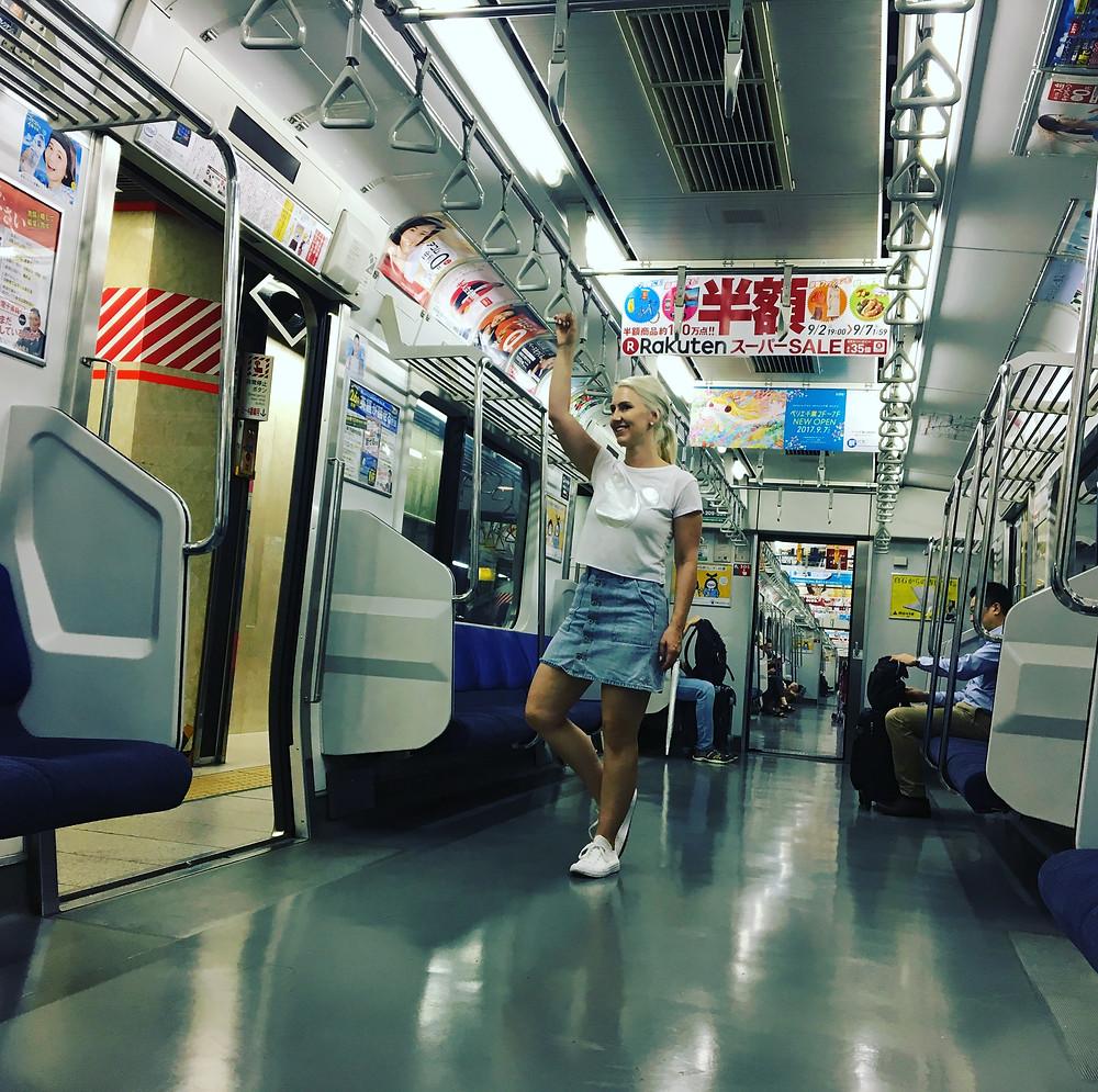 Riding the train from Shibuya to Tokyo Disneyland.