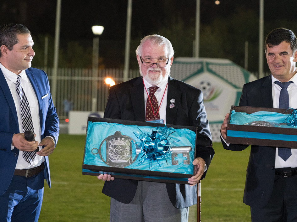 Rick (C), President of WAFF and Administrator of American Amputee Soccer Association, receives the keys to San Juan de Los Lagos, Mexico