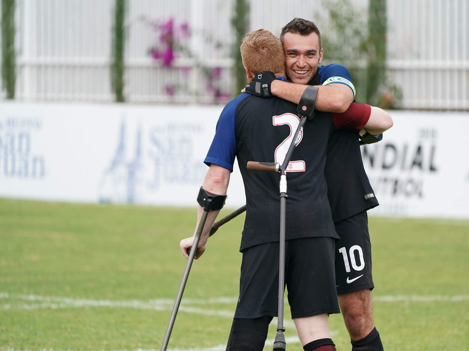 Keith (L) and Nico (R) celebrate a victory for Team USA at the 2018 Amputee Football World Cup
