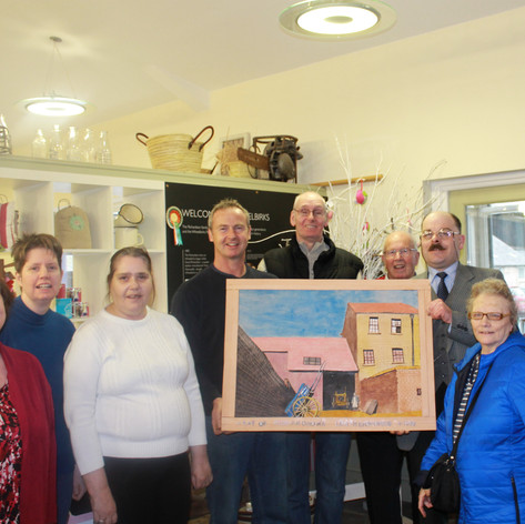 The Welcome Project presenting their Artwork to Wheelbirks Ice Cream Parlour