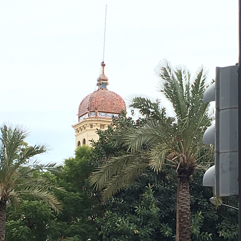 Top of Ayora Palace tower as seen above the palm trees from my street.
