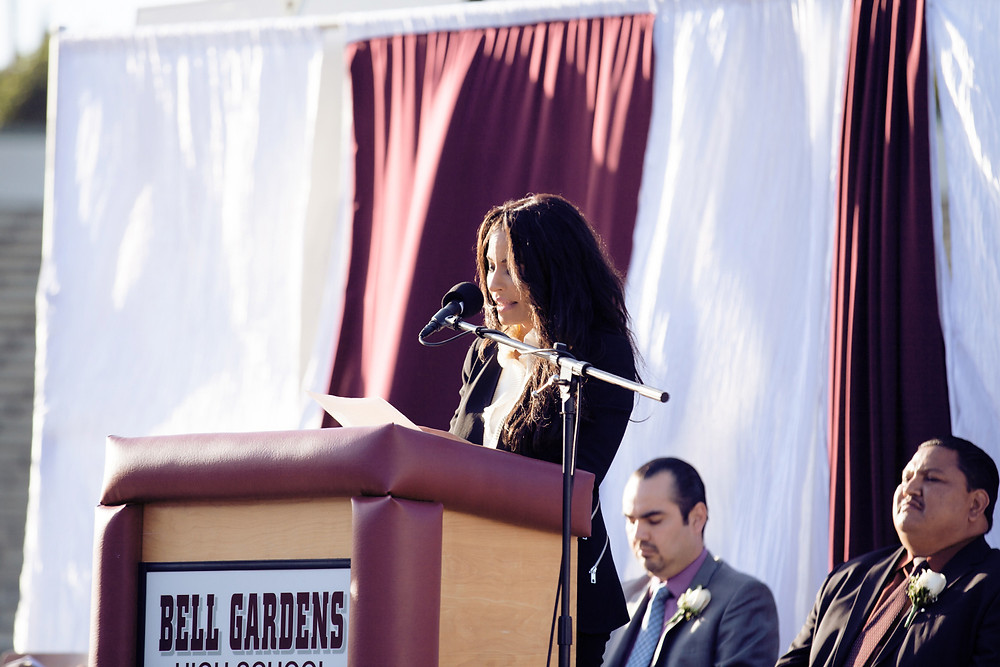 Kimberly Moore speaking to students at Bell Gardens High School ELAC kimberly moore foundation adopt a letter graduation