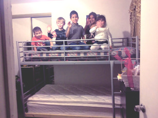ADOPT A LETTER DELIVERS BUNK BEDS TO A SPECIAL FAMILY IN NEED