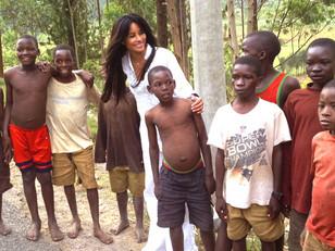 """KIMBERLY MOORE VISITS THE CHILDREN OF RWANDA ON ROUTE TO """"KWITA IZINA"""" IT'S 9TH ANNUAL GORILLA BABY"""