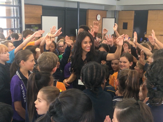 Kimberly Moore talks to students in Perth, Australia about the Power of Giving!