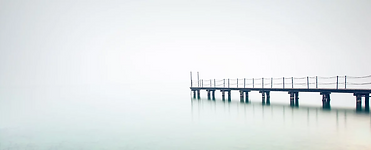 Foggy Water Photo with Pier