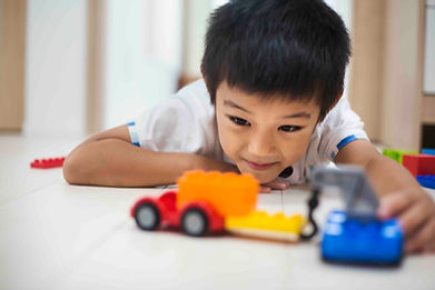 family-home-a-boy-playing-with-cars-on-t